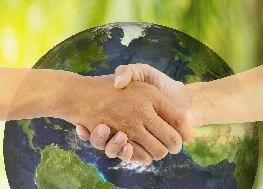two man hand shaking with earth background, Elements of this image furnished by NASA